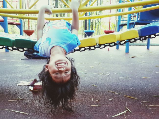 Happy child Playground Happy Kid Girl Faces Of Summer Playgrounds Fun Acrobatic Laugh Capturing Freedom