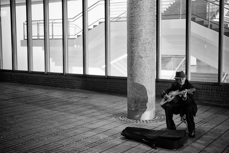 Alone Cologne Hat Köln Museum Ludwig Old Man Architectural Column Architecture Cold Evening Guitar Museum Music Musical Instrument Musician Playing Playing In Front Of A Museum Real People Sitting Street Musician Working For Money
