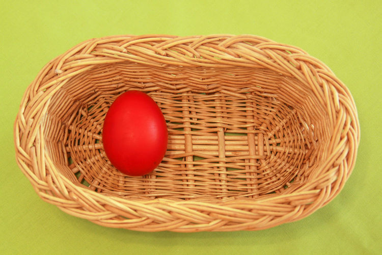 High angle view of red eggs in basket