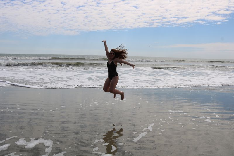 Miles EyeEm Selects Water Sea Beach Land Sky Motion Horizon Over Water Horizon Jumping One Person Beauty In Nature Nature Mid-air Enjoyment Arms Raised