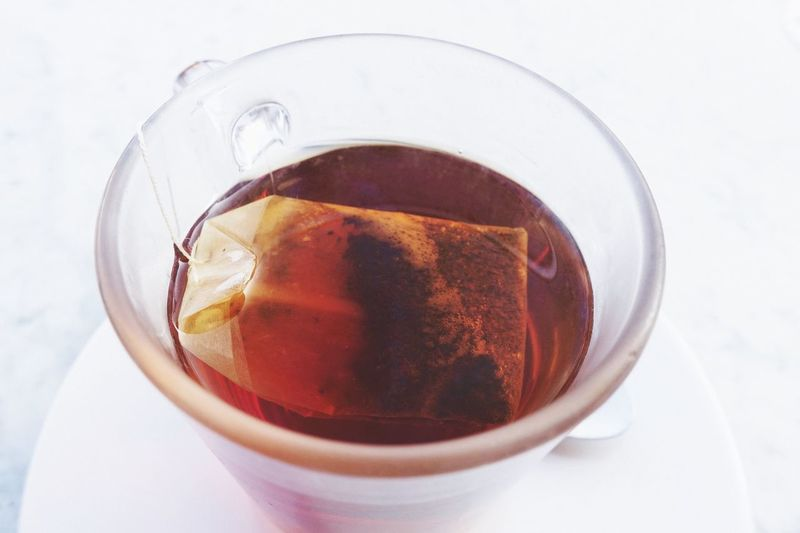 High angle view of coffee in glass on table