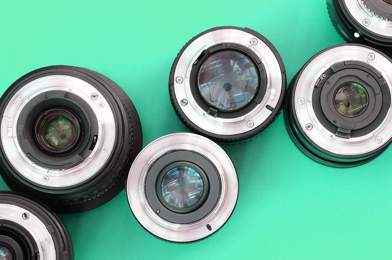 High angle view of camera against blue background