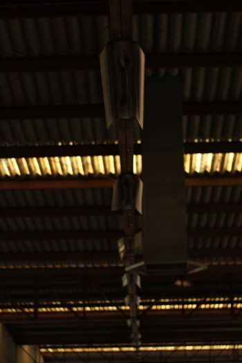 Architecture Built Structure Ceiling Close-up Electricity  Factory Focus On Foreground Illuminated Indoors  Industry Lighting Equipment Low Angle View Metal No People Pattern Selective Focus Technology