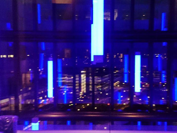 Defocused image of illuminated building at night