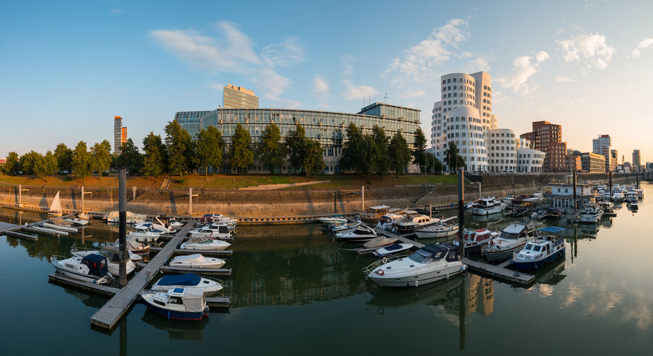 panoramic view of the media harbor in düsseldorf at sunset Cloud Düsseldorf Harbor Panorama Panoramic Reflection Rhine Sky And Clouds Artchitecture Built Structure Capital Germany Media Harbor Medienhafen North Rhine Westfalia Outdoors Rhine River Sky Sunset Transportation Travel Destinations Water Yacht Yachting