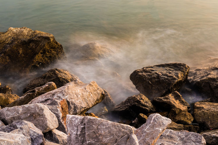 Rock Rock - Object Water Beauty In Nature Nature Sea Beach Rock Formation Scenics - Nature Wave Tranquility