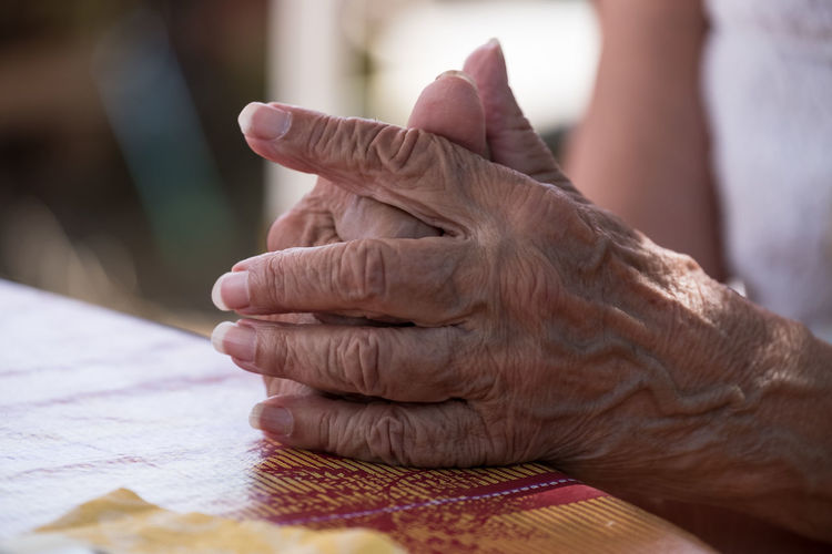 Close-Up Of Hands Of Senior Woman