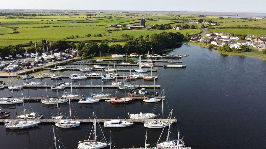 High angle view of boats moored at harbor