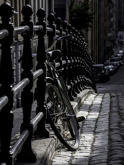 Railing Bicycle Building Exterior Built Structure City Focus On Foreground In A Row Land Vehicle Large Group Of Objects Metal Mode Of Transportation No People Outdoors Parking Stationary Street Transportation Wheel The Still Life Photographer - 2018 EyeEm Awards