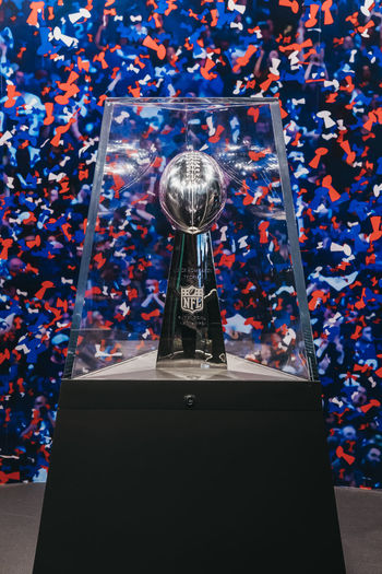 Superbowl trophy on in NFL Experience in Times Square, New York, a first-of-its-kind live action attraction, combining interactive games and 4D theatre. Tourism Travel United States USA New York City New York Superbowl Super Bowl Trophy NFL Experience No People Close-up NFL Display Cabinet NYC American Football - Sport Sport Museum Representation Celebration Event American Football - Ball Winner America Times Square NYC