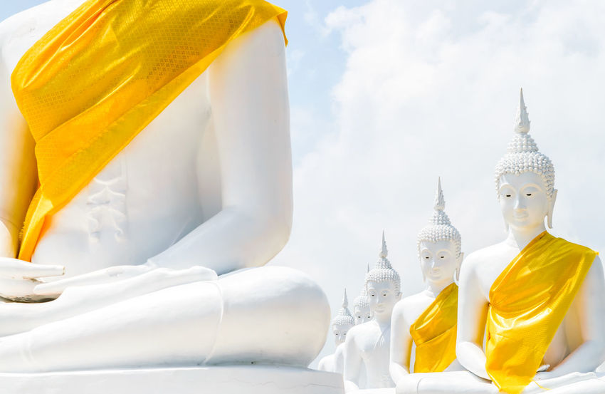 White buddha in thai temple Buddha Thailand Architecture Art And Craft Belief Building Built Structure Day Human Representation Idol Male Likeness Nature No People Outdoors Place Of Worship Religion Representation Sculpture Sky Spirituality Statue Yellow Robe