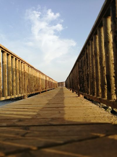 EyeEm Selects City Bridge - Man Made Structure Footbridge Sky Architecture Built Structure Cloud - Sky Empty Road The Way Forward Footpath Passageway Pathway Narrow Diminishing Perspective Elevated Walkway