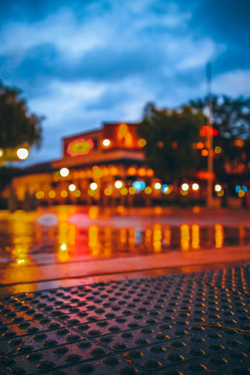 OUR RAINY LIGHTS No People Nature Illuminated Cloud - Sky Sky Night City Architecture Street Built Structure Building Exterior Pattern Outdoors Dusk Lighting Equipment Water Street Light Transportation Tree Light Surface Level Nightlife