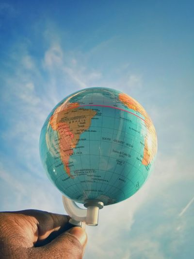 Man hand holding educational globe. Travel consept Human Hand Planet Earth Holding Space Astronomy Sky Close-up Cloud - Sky Globe Globe - Man Made Object Space Exploration World Map Spiral Galaxy Planetary Moon Space Travel Vehicle Personal Perspective Orbiting