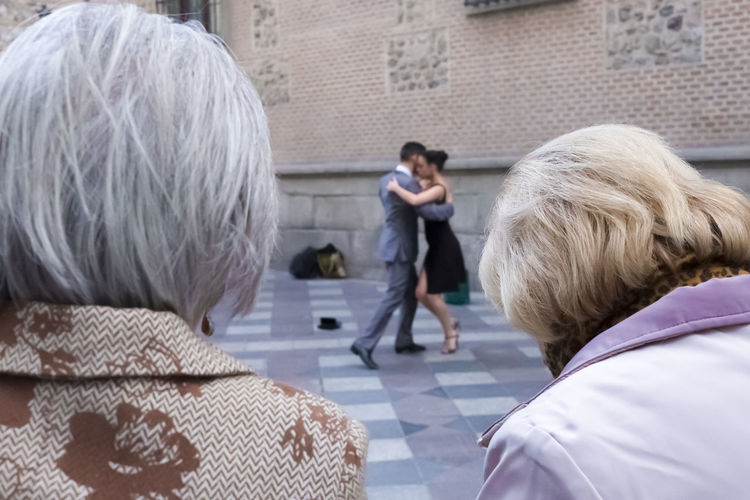 Two elderly women looking at a young couple dancing the tango in Madrid. City City Life City Street Dancing Fun Woman Adult Adults Only Blond Hair Close-up Entertainment Headshot Old Outdoors People Rear View Street Street Performers Tango Tango Dancers Women Young Adult Young People Young Women