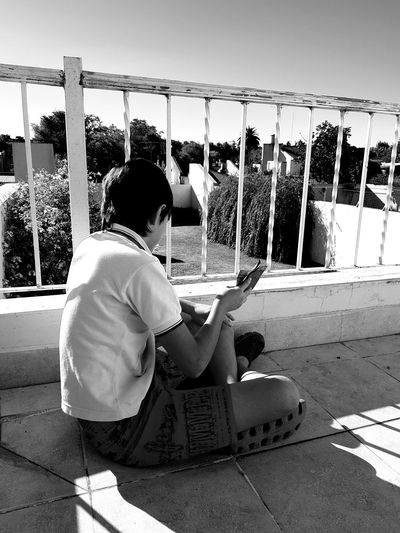 Good housekeeping (working on a summer day) From My Polnt Of View Monochrome EyeEm Best Shots - Landscape Working Day Eyeemphotography Bnw Shadow And Light Blackandwhite Nephew ♡ Children Photography Balcony View Indian Summer Summertime Full Length Sky Summer Sports
