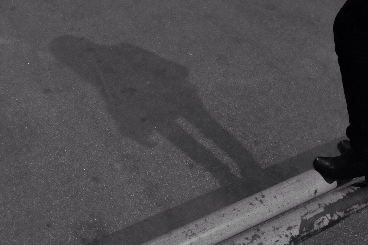 LOW SECTION OF MAN ON ROAD