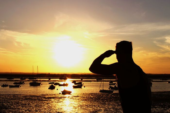 Sunset Silhouette Water Nautical Vessel Sky Sea Tranquility Person Tranquil Scene Sun Outdoors Beauty In Nature Nature Human Finger Nature Mersea Island