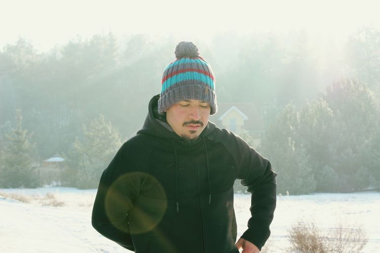 People One Man Only Cold Temperature Winter Snow Portrait Outdoors Traveling Home For The Holidays Warm Clothing Knit Hat Young Adult Young Men One Young Man Only Only Men Healthy Lifestyle Men One Person Beard Adults Only Nature Adult Lake