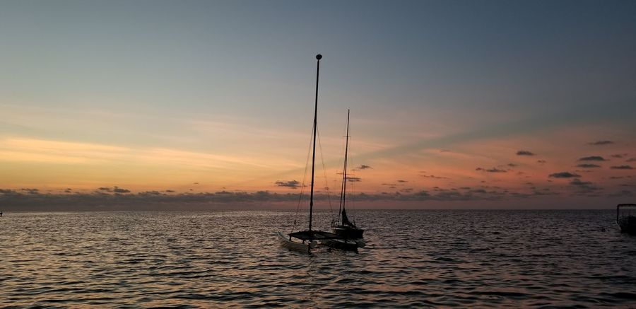 EyeEm Selects Water Sea Sunset Silhouette Sky Horizon Over Water Tranquil Scene Moored Nautical Vessel Sailboat Water Vehicle Tranquility Idyllic
