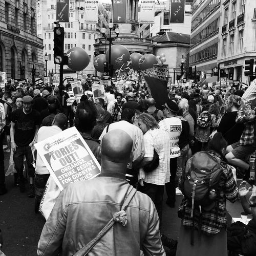 Large Group Of People Building Exterior City Men Built Structure Street London Demonstration Fitzrovia Protestor Protest Real People City Life Day Outdoors Social Issues Crowd Standing Police Uniform Togetherness Women Unity Postcode Postcards