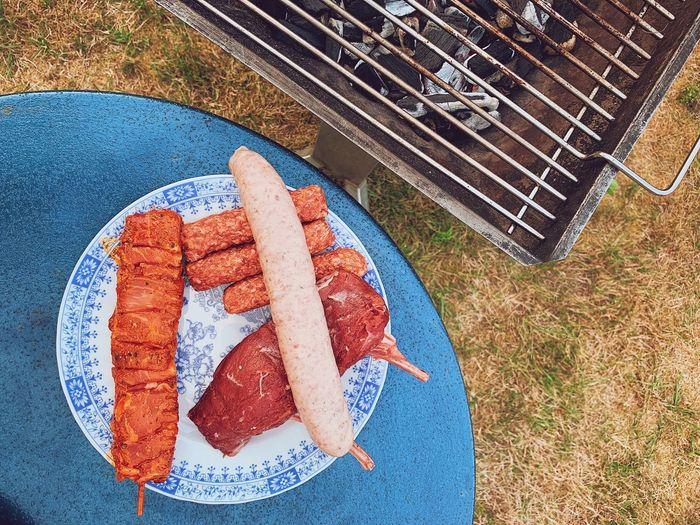 High angle view of human hand on barbecue