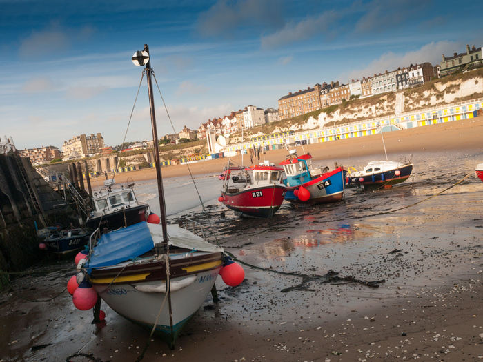 Broadstairs is a coastal town on the Isle of Thanet in the Thanet district of east Kent, England, about 80 miles (130 km) east of London Architecture Boat Broadstairs Building Exterior Built Structure City City Life Cloud Coastal Town Day Fishing Boat Harbour Mode Of Transport Nautical Vessel Ocean Outdoors Sea Shore Sky Tourism Town Transportation Vacations Water Waterfront