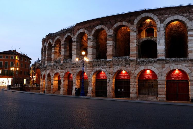 Evening lights at the Arena in the centre of Verona, Italy Evening Light Travel Photography Amphitheater Ancient Ancient Civilization Arch Archaeology Architectural Column Architecture Building Exterior Built Structure City Clear Sky Dusk History Illuminated Nature Night No People Street The Past Tourism Tourist Destination Travel Travel Destinations
