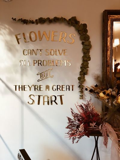 Coffee Quotes Flowers Coffee Text Western Script Wall - Building Feature Communication Indoors  No People Plant Day Decoration Wall