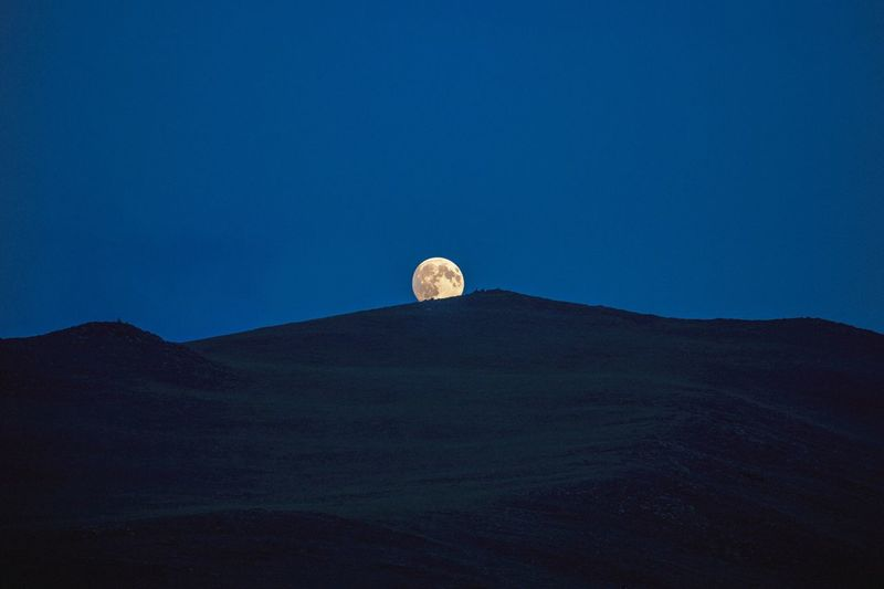 Rising moon Moon Sky Full Moon Scenics - Nature Beauty In Nature Space Night Land Nature Blue Low Angle View No People Astronomy Tranquil Scene Mountain Tranquility Copy Space Landscape Outdoors Environment