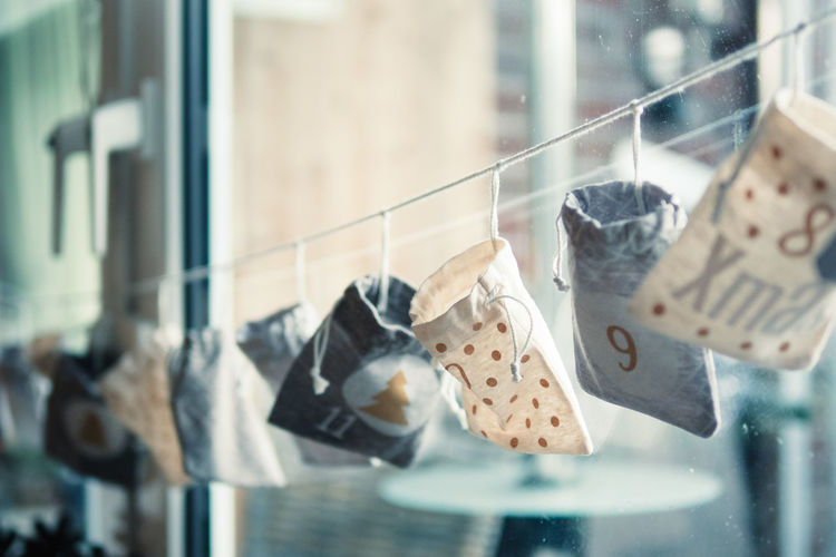 Close-Up Of Bags On Clothesline During Christmas