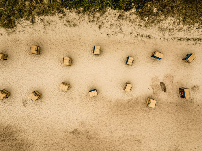 High angle view of footprints on sand