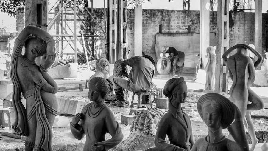 Worker making statues at workshop