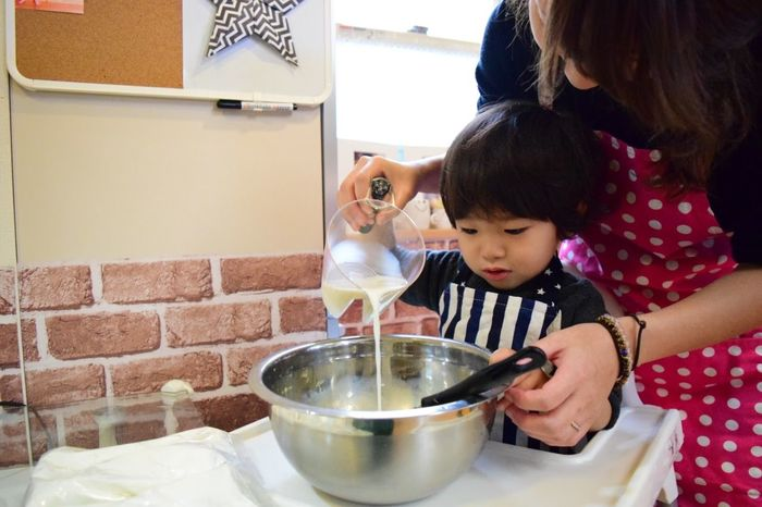 Domestic Kitchen Domestic Room Females Mixing Bowl Domestic Life Togetherness Preparation  Learning Child Stirring Assistance Childhood Two People Kitchen Bonding Mixing Bowl Girls Indoors  Casual Clothing