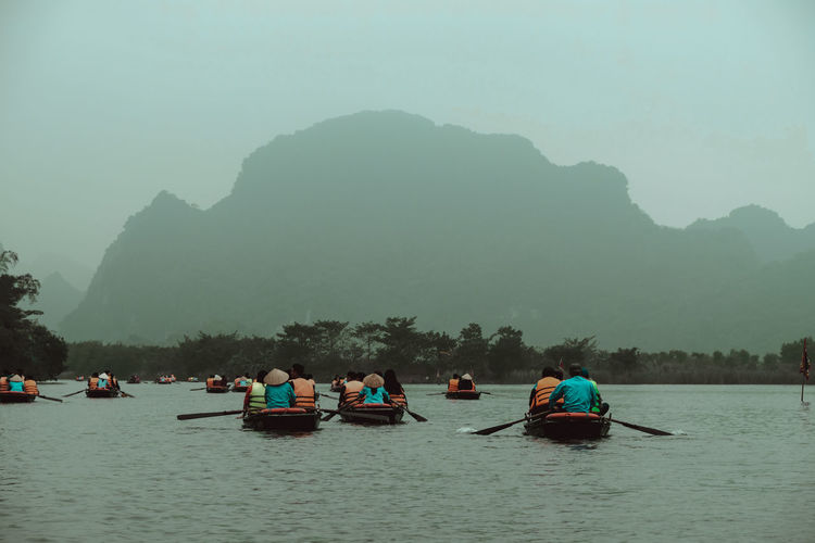 Kayaking in Trang An, Vietnam Foggy Weather Kayaking Kayaking In Nature Ninh Bình Tourist Attraction  Trang An Grottoes Trang An Tour Vietnam Beauty In Nature Blue Sky Canoa Cave Day Grotte Kayak Mountain Mountain Peak Mountains And Sky Nature Nature_collection Ninh Binh, Vietnam Outdoors River Tourist Destination Trang An The Traveler - 2018 EyeEm Awards