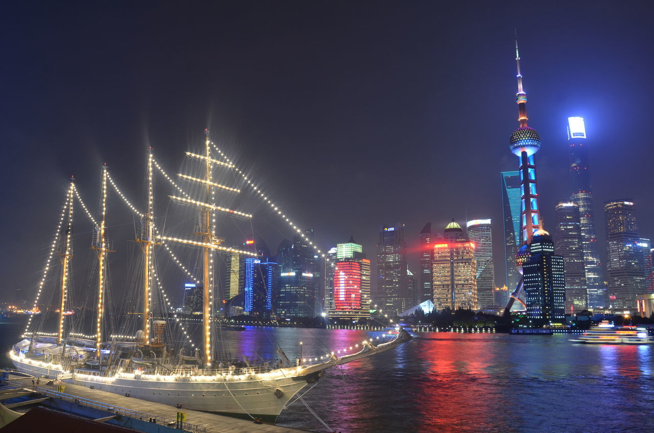 illuminated, night, architecture, built structure, building exterior, transportation, sky, travel destinations, waterfront, no people, water, celebration, city, outdoors, skyscraper, nautical vessel