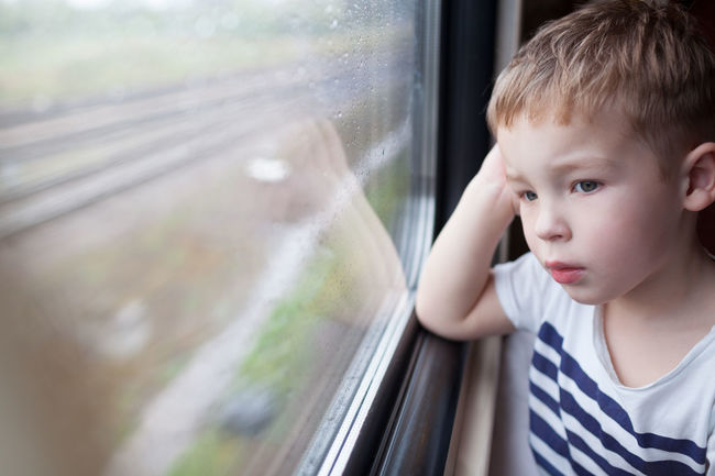 Boy Caucasian Child Commuter Kid Little Look Observe Passenger Rain Rainy Train Transport Travel Traveling Weather Window