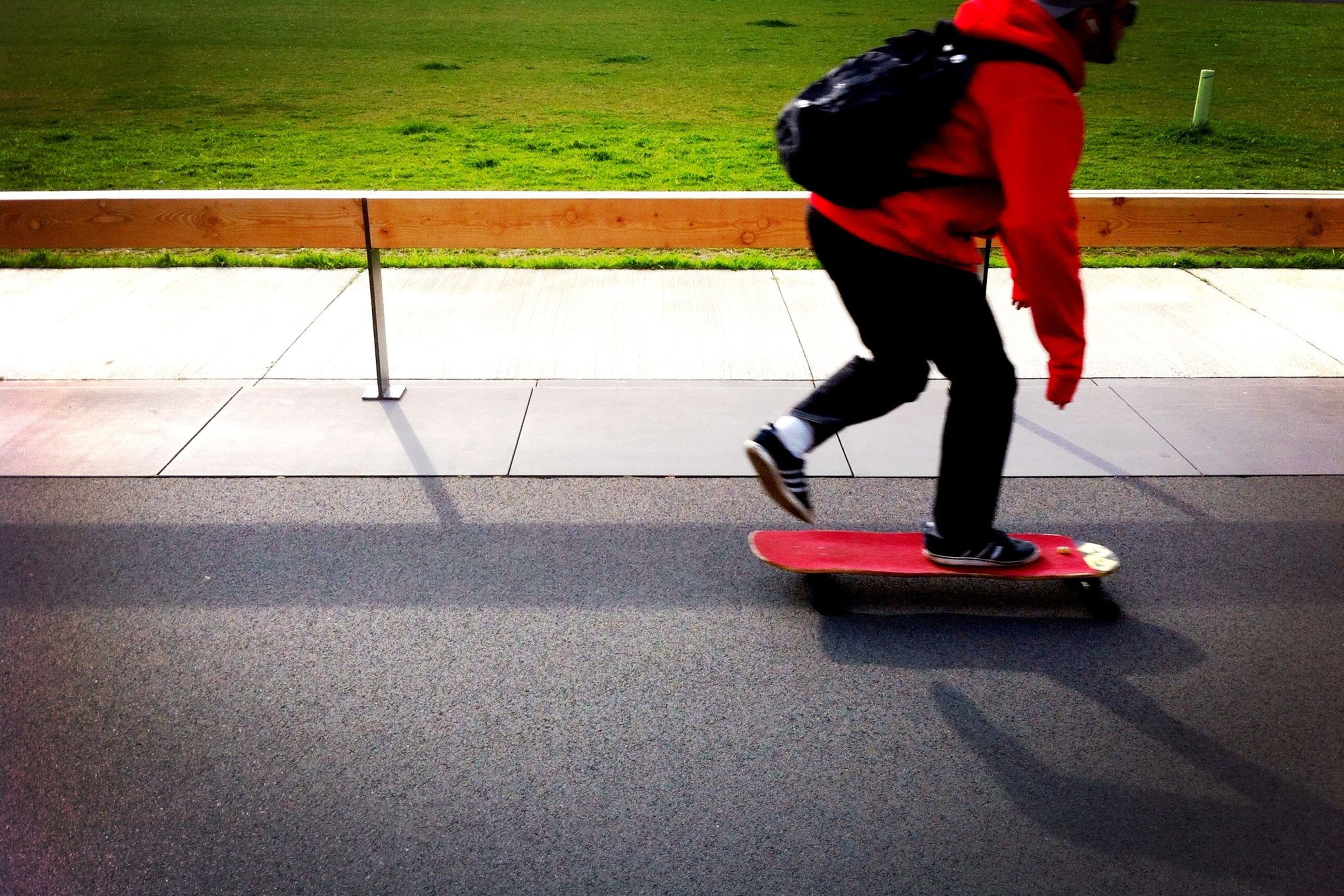 lifestyles, casual clothing, low section, full length, walking, street, men, leisure activity, childhood, rear view, motion, standing, person, red, on the move, skateboard, skateboarding, road