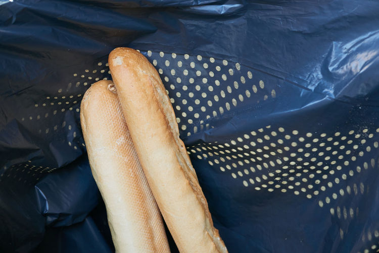 Baguette on black background