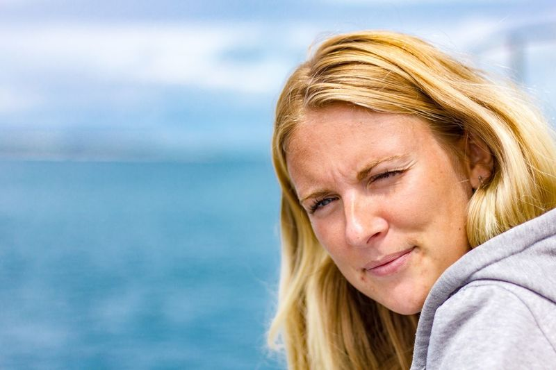 Close-up of mid adult woman against sea