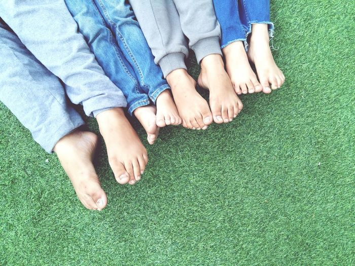 little legs Legs Kids Friendship Togetherness Playing Friends Children Childhood Activities Park Background Nature Lifestyle Feet Jeans Barefoot Human Foot Human Leg Human Body Part Relaxation Togetherness Grass Lying Down High Angle View People Day Bonding Leisure Activity Directly Above Casual Clothing