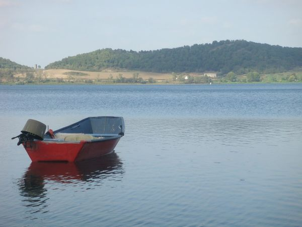 Water Vulcan Lake Nature No People Outdoors Day Sky Floating On Water red color Small Boat Martignano lake Lazium Italy Montain Green Color No People quietness Travel Destinations