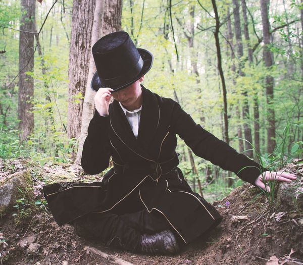 Full length of woman wearing hat in forest