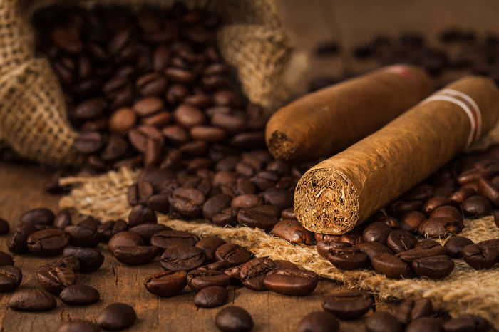 Cigarettes Brown Cigar Cigarette Time Close-up Coffe Coffee Bean Coffee Seeds Day Food Food And Drink Freshness Indoors  Large Group Of Objects No People Raw Coffee Bean Roasted Roasted Coffee Bean Sack Table