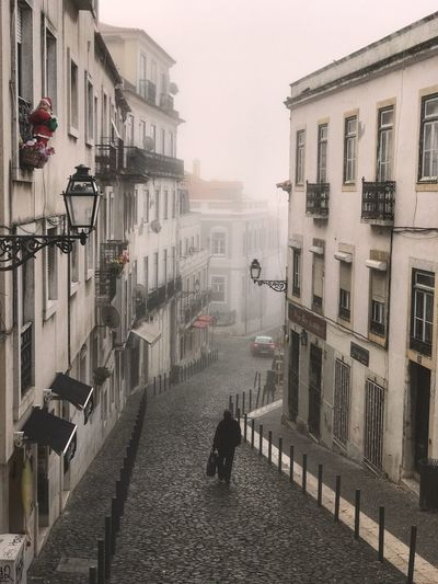 Morning walk in foggy Lisbon. View From The Top Peaceful Street Scene Architecture Europe Misty Foggy Morning Building Exterior Architecture Built Structure City Street Transportation Building Residential District Fog Outdoors Lifestyles Day Sky