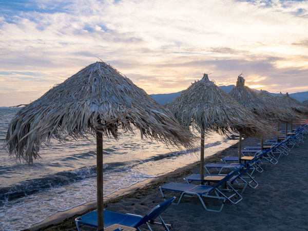 Beach umbrellas on Lesbos Aegean Sea Autumn Beach Beauty In Nature Cloud - Sky Greece Horizon Over Water Island Lesbos Nature No People Outdoors Sand Scenics Sea Sky Sun Lounger Sunset Tranquil Scene Tranquility Umbrella Vacations Wave