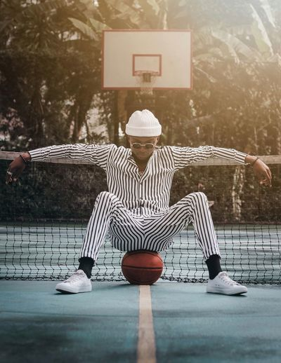 Stripes & Lines. Thoughtful Pose EyeEm Best Shots Canon Photography Fashion Protrait Basketball - Sport Men Sport Sitting Basketball