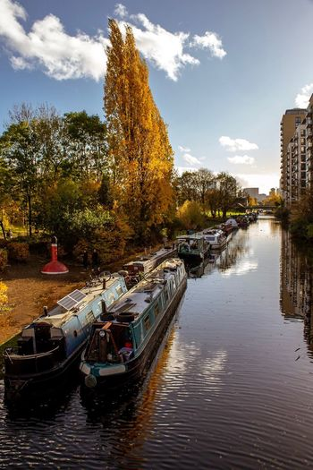 Autumn Colour Water Tree Nautical Vessel Sky Plant Architecture Building Exterior Mode Of Transportation Built Structure Nature Transportation Cloud - Sky River Waterfront Reflection No People Building City Outdoors
