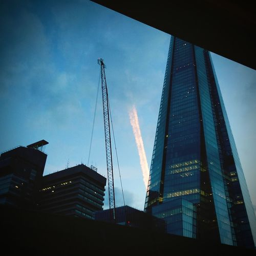 The Shard, London The Shard Dusk Tower Clouds And Sky Clouds Shard Vapourtrail Vapour Trail Cityscape phone photo,