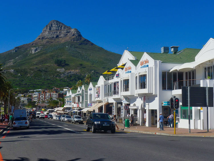 Architecture Blue Building Exterior Built Structure Camps Bay Car City Clear Sky Day House Lions Head Mountain Outdoors People Sky Sunlight Transportation